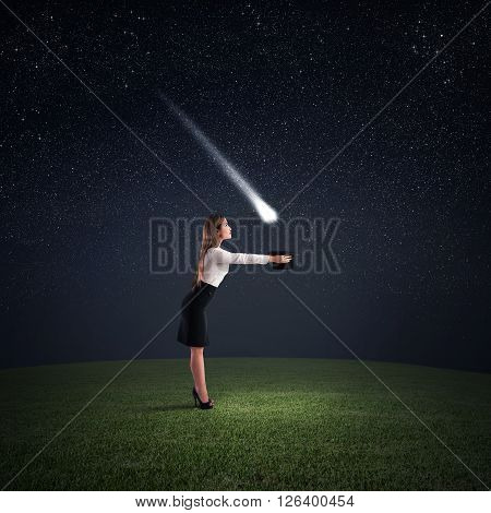 Woman takes a falling star with hat