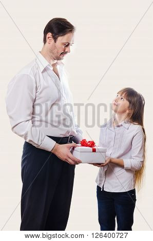 The father grants to the daughter a gift in a white box