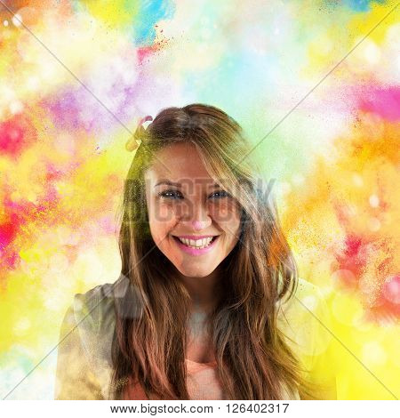 Laughing brunette girl with background color pigments