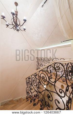 Staircase with wrought iron railings in modern home