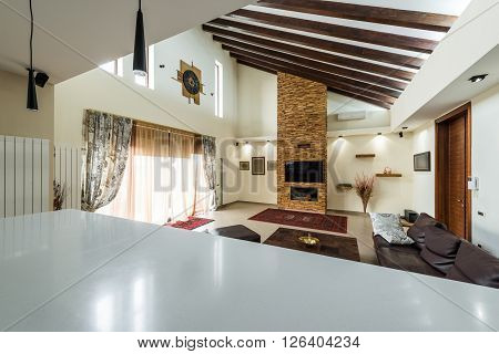 Breathtaking home interior with fireplace an luxury lather sofa