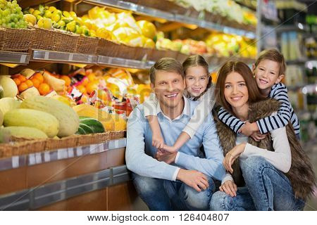 Happy family in store