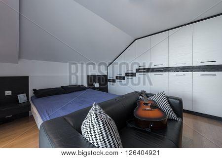 Master bedroom and dresser in attic interior