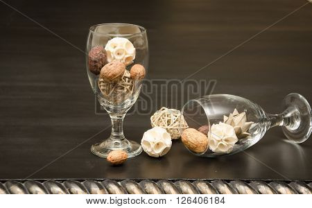 Overturned clear water goblet with textured balls