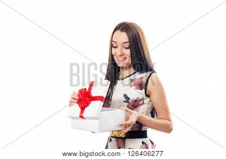 The young woman opens a gift and is surprised