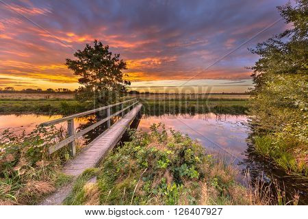 Wooden Walking Bridge At Sunset