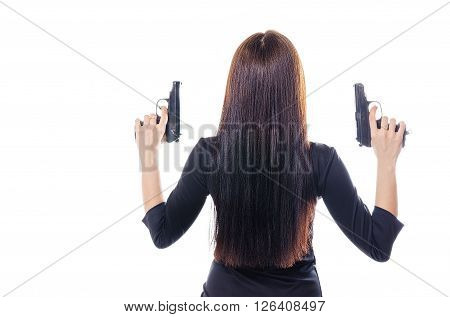 The beautiful woman holds two pistols in hand