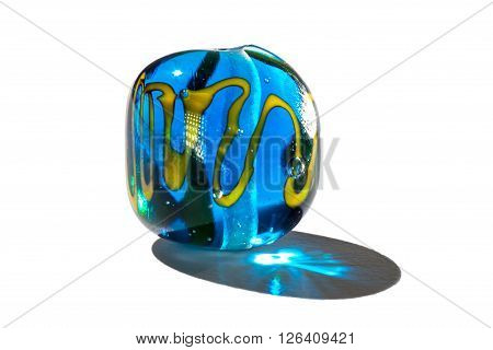 Hand made blue and yellow glass bead on white background