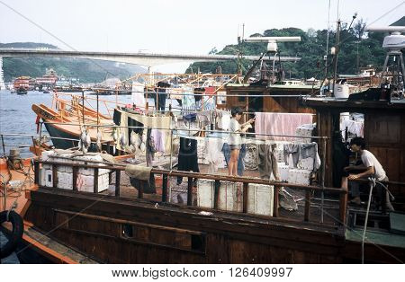 ABERDEEN / HONG KONG - CIRCA 1987: Families live on houseboats in the Aberdeen Floating Village in Hong Kong.