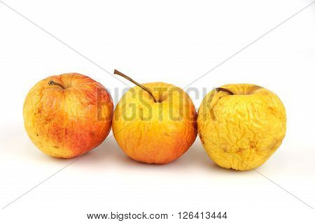 wrinkled and dried apples isolated on white background