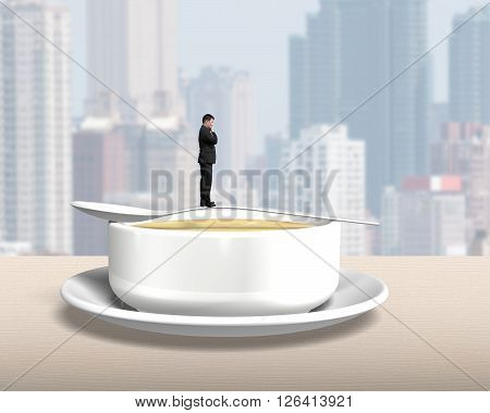 Thinking Man Standing On Spoon With Soup Bowl
