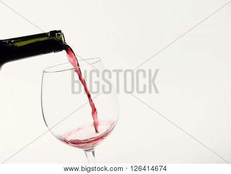 Alcoholic drink. Red wine pouring