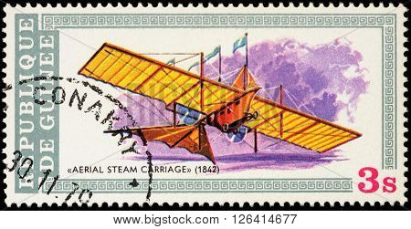MOSCOW RUSSIA - APRIL 17 2016: A stamp printed in Guinea shows the Aerial Steam Carriage a flying machine patented by William Henson in 1842 series