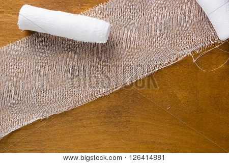 White gauze bandage on a wooden background