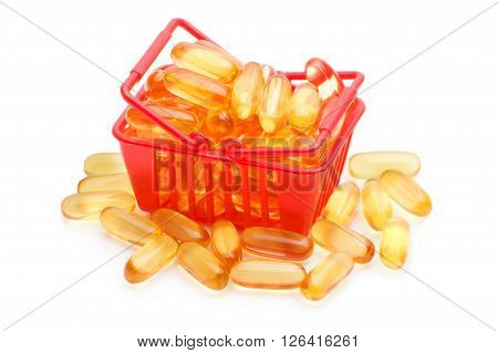 Cod liver oil Omega 3 gel capsules in the shopping basket, isolated on white background