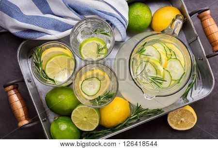 Summer refreshing beverage with citrus cucumber and rosemary
