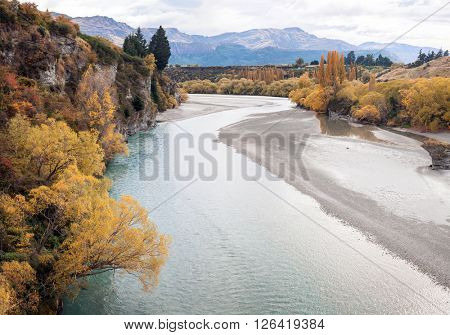 River and Lake From Historic Bridge with Mountain Landscape in Queenstowns New Zealand