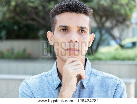 Thinking latin man with problems in the city
