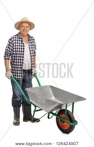 Agricultural worker posing with an empty wheelbarrow isolated on white background