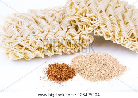 Unhealthy Flavoring Powder With Uncooked Instant Noodles In Backkground