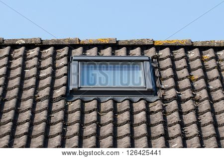 Modern dormer on a black tiled roof