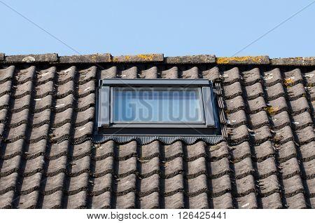 Modern dormer on a black tiled roof