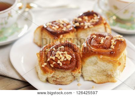 Sweet Buns With Cinnamon, Nuts And Caramel Syrup