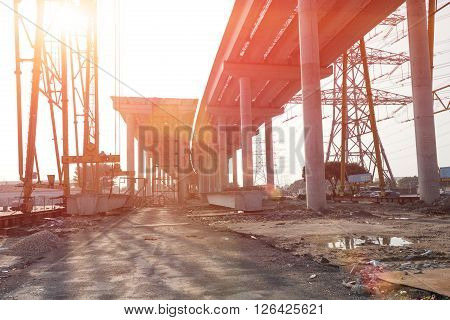 concrete highway under construction against the sun