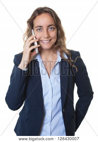 Blond businesswoman with blue eyes and blazer talking at phone on an isolated white background for cut out
