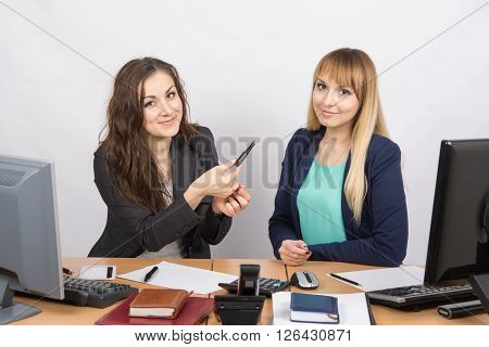 Office Girl Sitting Next To A Colleague Offers Lipstick