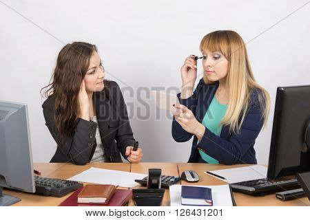 Office Worker Watches As A Colleague Paints Eyelashes At Your Desk