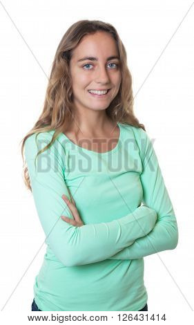 Happy blonde caucasian woman with blue eyes and crossed arms on an isolated white background for cut out