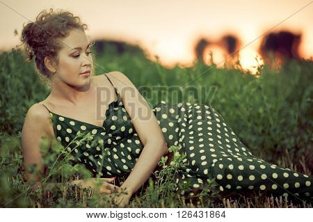Picture of beautiful sexy woman lying on grass