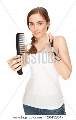 Hairdresser holding a scissors and comb isolated on white focus on comb)