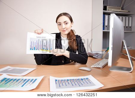 Businesswoman with financial reports at the office
