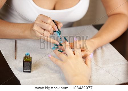 Picture of beautician doing manicure with nail varnish