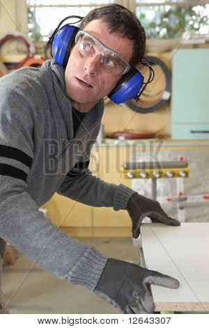 Carpenter in workshop
