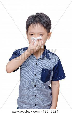 Young asian boy wipe his nose by tissue paper