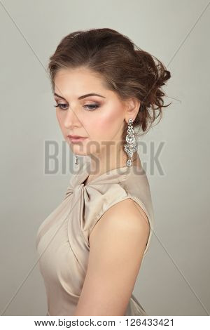 Beautiful glamour woman in evening dress with make up