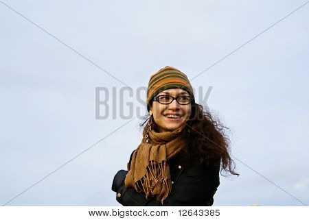 The girl in a cap and a scarf