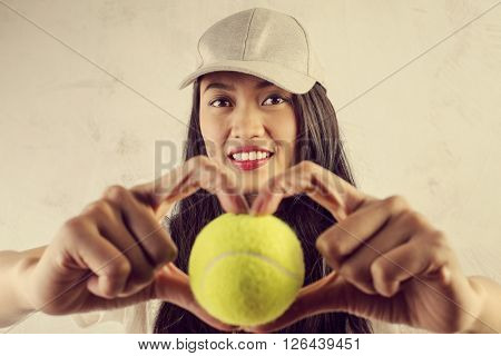 Sporty woman with tennis ball
