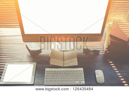 Mock up of home desktop with pc computer and touch pad with blank copy space screen for your promotional content keyboard with mouse sunglasses little notepad books modern hipster work space