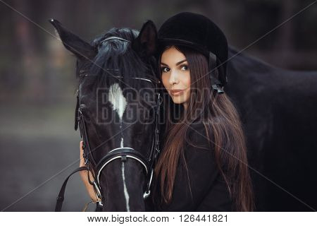 Beautiful young girl smile at her horse dressing uniform competition: outdoors portrait