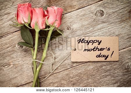 Mothers day card with roses on wooden board.
