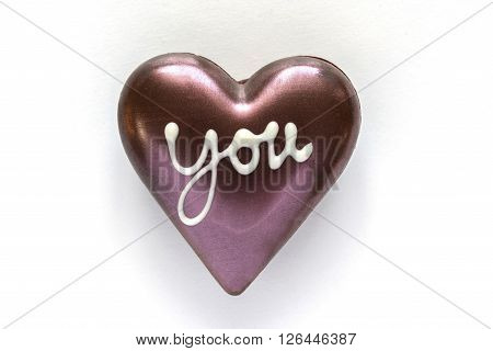 Chocolate heart shaped with word you on white background included clipping path