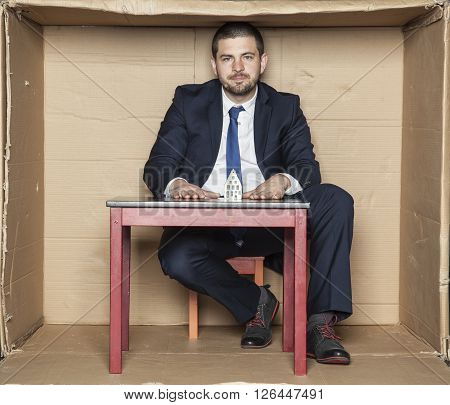 Businessman And His Desk With A Model Home