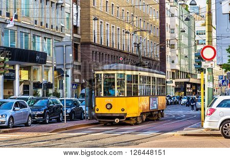 Milan, Italy - May 8, 2014: Old tram in the historic centre of  Milan. In operation since 1881, the tram network is now 170 kilometers long