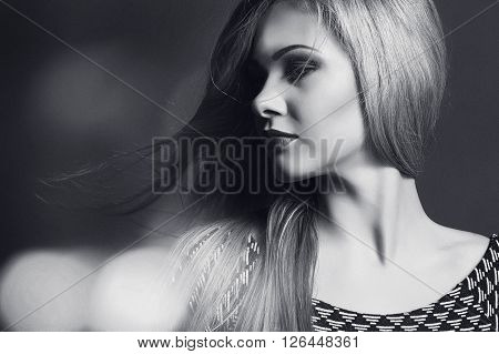 beautiful and sexy blond girl with long hair make-up portrait