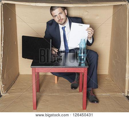 Businessman Signs Own Dismissal