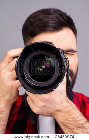 Close Up Photo Of Man's Hands Holding Digital Camera